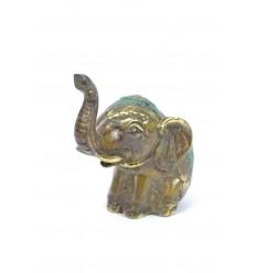 Statuette éléphant trompe en l'air. Fabrication artisanale en bronze.