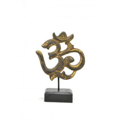 Statuetta simbolo 'm (Aum) legno intagliato. Decorazione indiana.