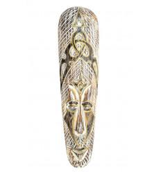 Masque africain bois blanchi motif tribal, décorer un mur noir mat.