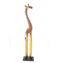 Great statue giraffe standing up in the wood, ethnic decoration african.