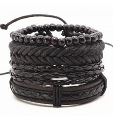 Manchette pour homme. Ensemble 4 bracelets noirs très tendance.