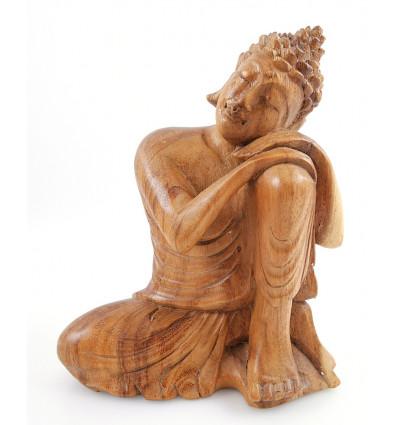Statue de Bouddha penseur en bois brut. Décoration Zen asiatique.