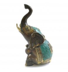 Statuette elephant sitting trunk up in the air in Bronze. Lucky Feng Shui.