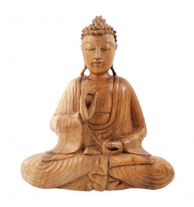Statuette Bouddha assis en bois naturel, mûdra de l'éducation.